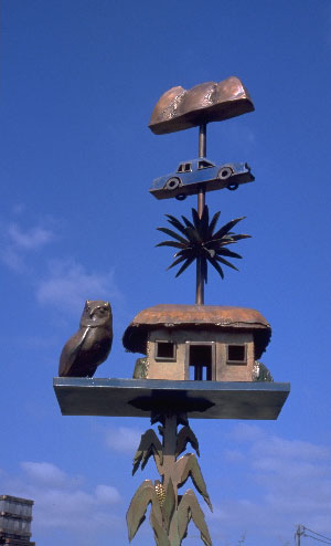 house sculpture fashioned like weather vanes